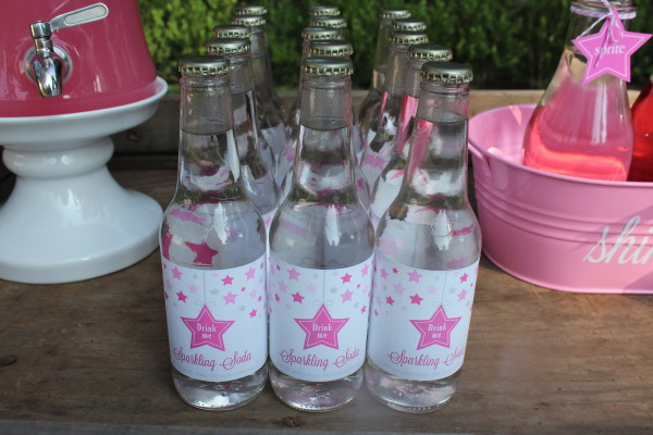 "Drink Station- The drinks were set up on an old wagon that we had. Luckily, it had pink wheel rims.  The girls picked from ""star""berry soda, sparkling soda, lemonade and personalized water bottles."
