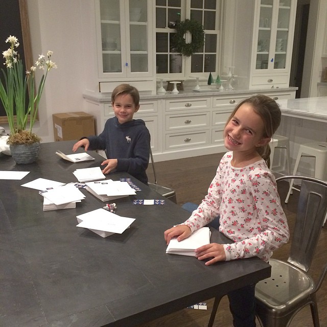 Stuffing Christmas card is so much easier with my little twin elves.  Next year Bloom will be offering Christmas cards. So happy with how our first design came out.  #twinsrule #christmascard #fridaynight